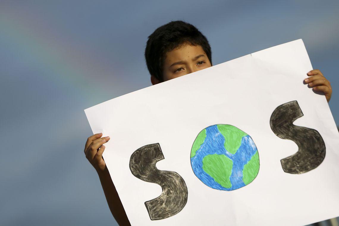 Durante de ato realizado por estudantes em Brasília para sensibilizar o governo contra o aquecimento global